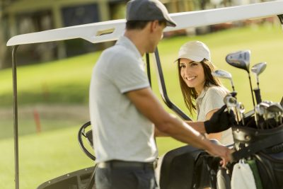 Young couple at golf cart - golf pos software